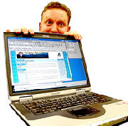 Jamie hiding behind a laptop